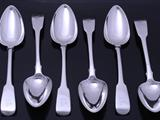 Set of six George III sterling silver fiddle pattern table spoons