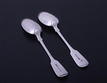 A pair of William IV fiddle pattern sterling silver dessert spoons