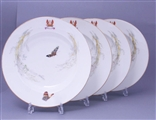 Attractive set of four Victorian armorial porcelain soup plates