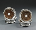 A set of four George III silver Wine Coasters