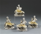 A set of four Victorian Figural Salt Cellars