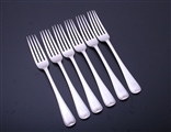 A set of six Victorian feather edge pattern sterling silver table forks