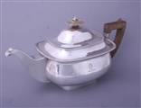 A George III three piece sterling silver tea set