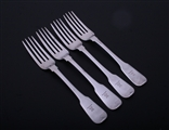 A set of four George III sterling silver fiddle pattern table forks