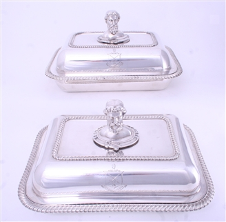 Pair of early 19th century Old Sheffield Plate entrée dishes and covers with armorial finials