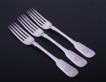 A set of three Victorian sterling silver fiddle pattern table forks