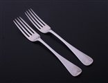 A pair of Victorian Old English pattern sterling silver table forks