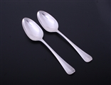 A pair of George III Hanoverian pattern sterling silver table spoons