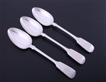 A matched set of three Victorian fiddle pattern sterling silver table spoons