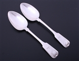 A pair of George III fiddle pattern sterling silver table spoons