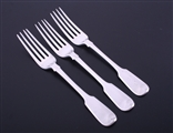 A set of three George IV fiddle pattern sterling silver table forks