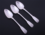 A set of three George III fiddle pattern sterling silver table spoons