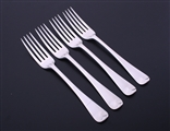 A set of four George III Old English pattern sterling silver table forks