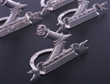A set of four Victorian sterling silver heraldic menu card holders