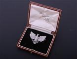 A fine and rare ruby and diamond heraldic brooch
