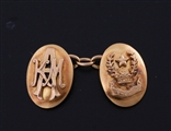 A fine pair of 18ct yellow gold armorial cufflinks