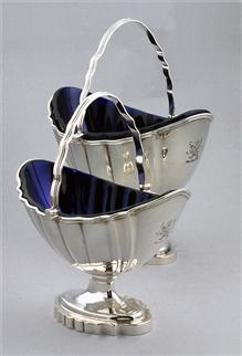 A pair of George III Swing Handled Sugar Baskets