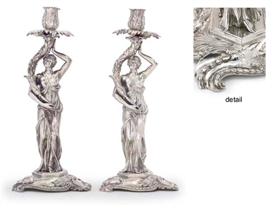 A magnificent and rare matched pair of George III and George IV silver candlesticks