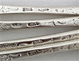 George II Sterling Silver Set of Four Rococo Chased Hanoverian Pattern Dessert Spoons 1741