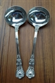 A pair of Antique Victorian Sterling silver Queens pattern sauce ladles 1855