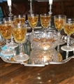 A set of cut glass armorial sherry glasses and a bowl