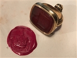 A George IV gold and carnelian armorial seal for COFFIN and HARRINGTON