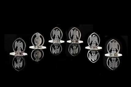 REGIMENTAL INTEREST: A matched set of six sterling silver menu holders