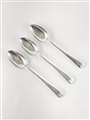 A set of three antique hallmarked sterling silver dessert spoons, Old English pattern 1764