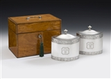 THE FAULKBOURN HALL CASED TEA CADDIES. AN IMPORTANT & VERY UNUSUAL PAIR OF GEORGE III TEA CADDIES MADE IN LONDON IN 1793 BY WILLIAM FRISBEE. ALL CONTAINED WITHIN A CONTEMPORARY SATINWOOD CASE, THE HINGES AND HANDLE ALSO HALLMARKED FOR 1793