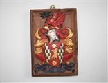 A fine 17th century carved giltwood and polychrome decorated oak armorial panel