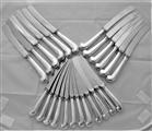 Good crested set of 12+12 pistol handled George II silver dinner & dessert knives C1740