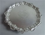 AN EARLY GEORGE III SALVER MADE IN LONDON IN 1761 BY EBENEZER COKER.